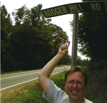 picture of a street sign with the name Booger Hill Road